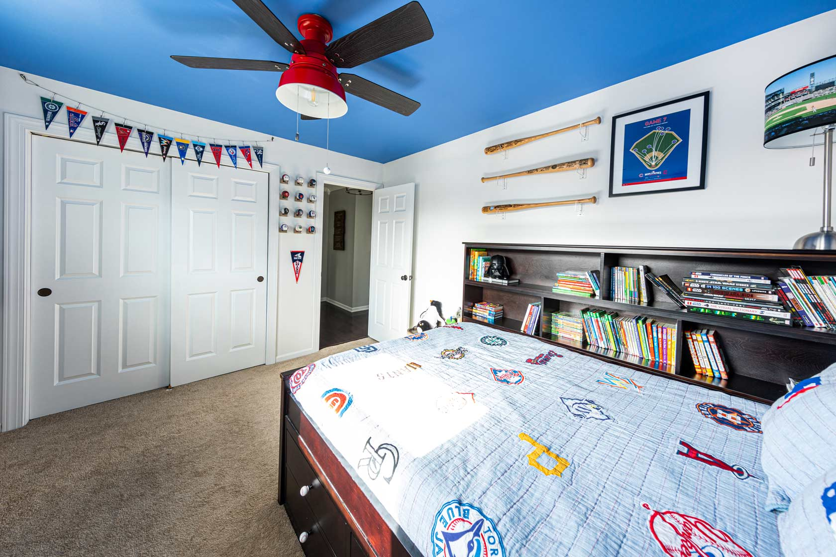 Baseball bedroom with red ceiling fan