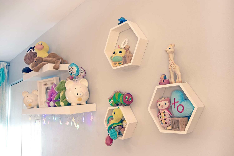 Floating shelves in a nursery